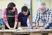 stock photo of carpentry  - Young people in carpentry course with teacher - JPG