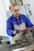 stock photo of ironworker  - Young woman studying ironworks in professional school - JPG
