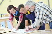 picture of carpentry  - Young people in carpentry course with teacher - JPG