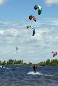 pic of kites  - Kiteboarding competition many kites in the sky - JPG