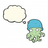 picture of crazy hat  - cartoon alien head wearing hat with thought bubble - JPG