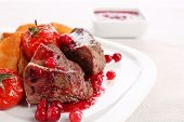 image of deer meat  - Tasty roasted meat with cranberry sauce and roasted vegetables on plate - JPG