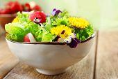 stock photo of eat me  - Light organic salad with flowers - JPG