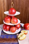 stock photo of serving tray  - Tasty ripe apples on serving tray on wooden background - JPG