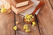 picture of roughage  - Old books with dry flowers and lemon on table close up - JPG