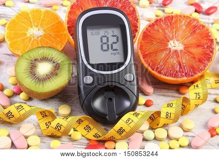 Glucometer With Result, Centimeter, Fruits And Medical Pills, Diabetes, Slimming, Healthy Lifestyle