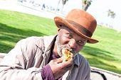 Elderly Man Eating Hotdog