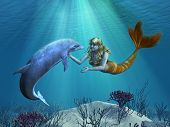 picture of undersea  - A friendly dolphin greets a mermaid undersea  - JPG