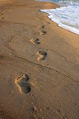 image of footprints sand  - Footprints in the sand in the gulf of thailand - JPG