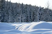 stock photo of barchan  - The magnificent barchans of snow covered by the evening sun on a background of snow - JPG