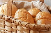 Basket of freshly baked dinner rolls.  Close-up with shallow dof.