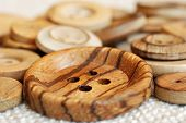 Vintage wooden buttons on homespun fabric.  Macro with extremely shallow dof.
