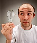 Man Holding Electrical Bulb