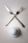 One egg with crossed knife and fork