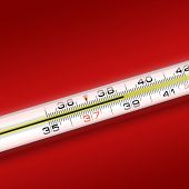 close-up thermometer on red background