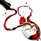 foto of wine-glass  - Heart from pouring red wine in goblet with red rose isolated on white - JPG