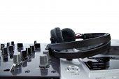dj mixer with headphones isolated on white