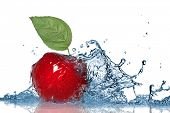 Red apple and water splash isolated on white