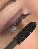 Closeup of a young beauty applying makeup.