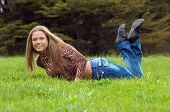 Cheerful Girl Laying On The Grass