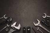 Flat Lay With Different Wrenches, Monkey Wrench And Nuts On Grey Surface poster