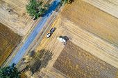 Aerial Drone View Of Harvester Combine Working On Field. Summer Harvest. Farm Works poster