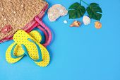 Yellow Sandals With Woven Handbags On Blue Color Background, Summer Holidays Accessories . Flat Lay  poster