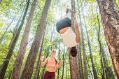 Man and woman doing functional fitness and sport in outdoor gym poster