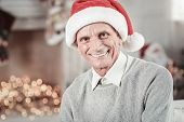 Be Positive. Delighted Male Person Expressing Positivity And Wearing Christmas Hat While Looking At  poster
