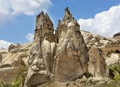 Stone Conical Houses In The Ancient Rocks Of Goreme, Cappadocia. Rural Landscape In The Rural Way Of poster