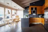 Front view modern wooden kitchen with table and chairs. Nobody inside poster