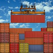 Stack of Freight Containers at the Docks with Crane