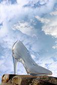 Glass High Heel Shoe On Rocky Stone Surface