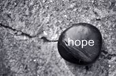 foto of hope  - The word hope on a zen stone against concrete - JPG