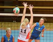 KAPOSVAR, HUNGARY - OCTOBER 21: Zsanett Pinter (R) in action at a Hungarian NB I. League volleyball