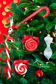 Noble Pine Christmas Tree Decorated With Candy Cands And Ornaments