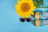 Fashion Flatlay With Sunglasses, Espaddrille Sandals And Bright Big Yellow Sunflower On Blue Backgro poster