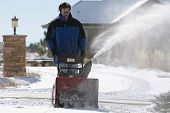 Man Snowblowing In Wintertime