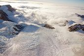 aerial view of franz josef glacier from helicopter in New Zealand Sunset