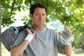 Sporty man with bottle of water