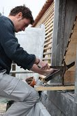 stock photo of burlington  - Roofer working with slate - JPG