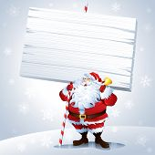 Santa holding a blank sign