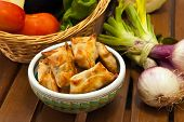 pic of samosa  - fried beef samosas with vegetables on basket - JPG