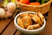 stock photo of samosa  - fried beef samosas with vegetables on bowl - JPG