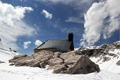 Snowy Alpine Landscape With Church In Germany