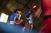 foto of pugilistic  - Sport and people two men exercising and fighting in boxing gym - JPG