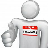 A person wearing a nametag reading Hello I Am a Winner extends a hand for a handshake, as a successf