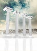 four columns in the ancient Greek Ionian style in row on cityscape backgroung