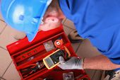 stock photo of electricity meter  - Man with electricity measurer - JPG