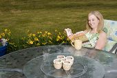 Woman On Patio With Coffee And Book
